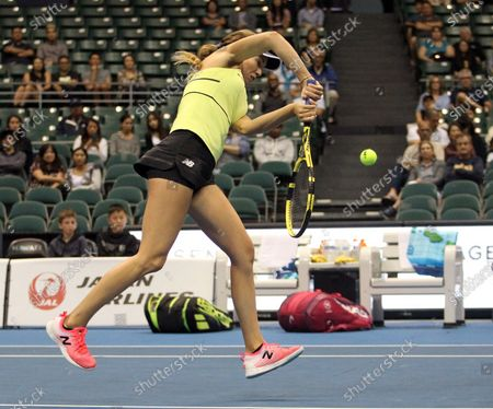 Danielle Collins returns volley at the net in a mixed doubles exhibition match at the Hawaii Open invitational tournament between teams Danielle Collins/Sam Querrey and Yanina Wickmayer/Christian Harrison at the Stan Sheriff Center in Honolulu, HI - Michael Sullivan/CSM