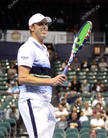 Sam Querrey reacts to a play in a mixed doubles exhibition match at the Hawaii Open invitational tournament between teams Danielle Collins/Sam Querrey and Yanina Wickmayer/Christian Harrison at the Stan Sheriff Center in Honolulu, HI - Michael Sullivan/CSM