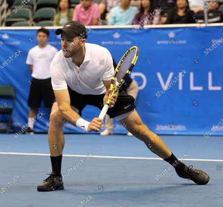 Christian Harrison returns volley in a mixed doubles exhibition match at the Hawaii Open invitational tournament between teams Danielle Collins/Sam Querrey and Yanina Wickmayer/Christian Harrison at the Stan Sheriff Center in Honolulu, HI - Michael Sullivan/CSM