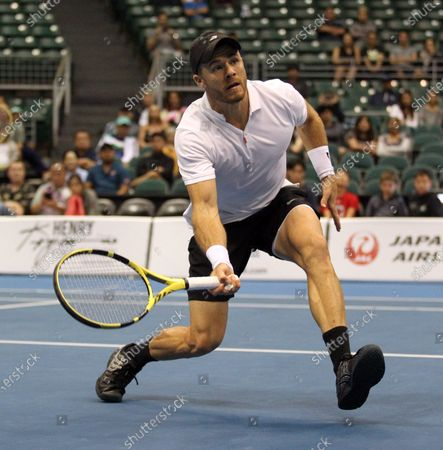 Christian Harrison runs to the net in a mixed doubles exhibition match at the Hawaii Open invitational tournament between teams Danielle Collins/Sam Querrey and Yanina Wickmayer/Christian Harrison at the Stan Sheriff Center in Honolulu, HI - Michael Sullivan/CSM