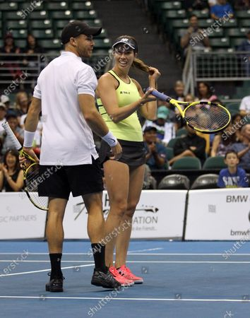 Christian Harrison and Danielle Collins chuckle about a call in a mixed doubles exhibition match at the Hawaii Open invitational tournament between teams Danielle Collins/Sam Querrey and Yanina Wickmayer/Christian Harrison at the Stan Sheriff Center in Honolulu, HI - Michael Sullivan/CSM