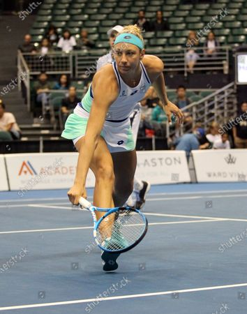 Yanina Wickmayer runs to the net in a mixed doubles exhibition match at the Hawaii Open invitational tournament between teams Danielle Collins/Sam Querrey and Yanina Wickmayer/Christian Harrison at the Stan Sheriff Center in Honolulu, HI - Michael Sullivan/CSM