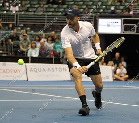 Christian Harrison hits a return shot in a mixed doubles exhibition match at the Hawaii Open invitational tournament between teams Danielle Collins/Sam Querrey and Yanina Wickmayer/Christian Harrison at the Stan Sheriff Center in Honolulu, HI - Michael Sullivan/CSM