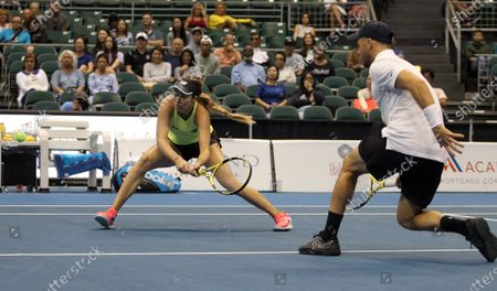 Danielle Collins returns volley in a mixed doubles exhibition match at the Hawaii Open invitational tournament between teams Danielle Collins/Sam Querrey and Yanina Wickmayer/Christian Harrison at the Stan Sheriff Center in Honolulu, HI - Michael Sullivan/CSM