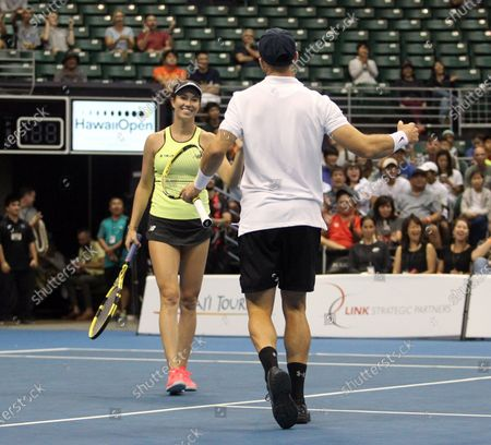 Christian Harrison and Danielle Collins celebrate the win in a mixed doubles exhibition match at the Hawaii Open invitational tournament between teams Danielle Collins/Sam Querrey and Yanina Wickmayer/Christian Harrison at the Stan Sheriff Center in Honolulu, HI - Michael Sullivan/CSM
