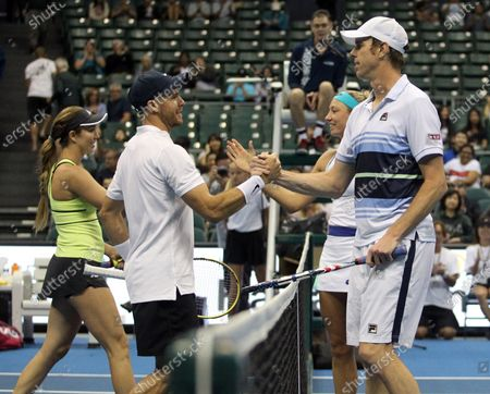 Opponents shake hands after a mixed doubles exhibition match at the Hawaii Open invitational tournament between teams Danielle Collins/Sam Querrey and Yanina Wickmayer/Christian Harrison at the Stan Sheriff Center in Honolulu, HI - Michael Sullivan/CSM