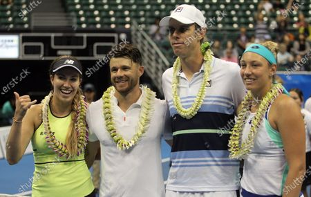 Participants all pose after a mixed doubles exhibition match at the Hawaii Open invitational tournament between teams Danielle Collins/Sam Querrey and Yanina Wickmayer/Christian Harrison at the Stan Sheriff Center in Honolulu, HI - Michael Sullivan/CSM