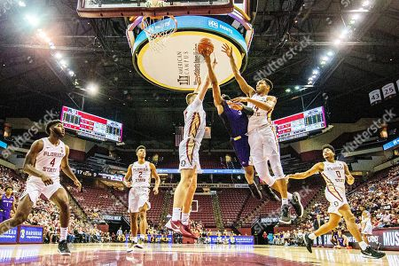 Stock Picture of Balsa Koprivica,Jamari Blackmon,Devin Vassell. North Alabama guard Jamari Blackmon tries to shoot between Florida State center Balsa Koprivica (5) and Florida State guard Devin Vassell (24) in the first half of an NCAA college basketball game in Tallahassee, Fla