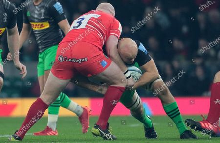 Dan Cole of Leicester tackles by Tom Lawday of Harlequins