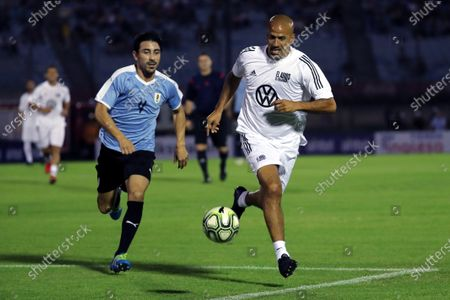 Argentine former soccer player Juan Sebastian Veron (R) in action against Jorge Fucile (L) during the Uruguayan footballer Diego Forlan's farewell match, played at the Centenario Stadium in Montevideo, Uruguay, 28 December 2019.