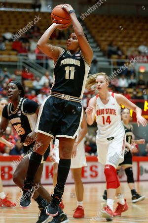 Purdue guard Dominique Oden, left, goes up for a shot in front of Ohio State forward Dorka Juhasz during an NCAA basketball game on in Columbus, Ohio. Purdue won 66-50