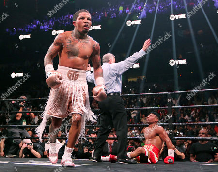 Gervonta Davis, left, heads to the corner as Yuriorkis Gamboa, right, looks up at referee Jack Weiss during the WBA secondary lightweight title boxing bout early, in Atlanta. Davis won when the fight was stopped in the 12th round
