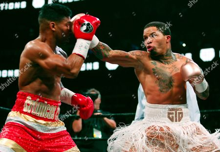 Gervonta Davis, right, lands a punch on Yuriorkis Gamboa during round eight for the WBA lightweight boxing bout, in Atlanta. Davis won the title by a 12th round TKO