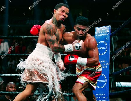 Gervonta Davis, left, lands a punch on Yuriorkis Gamboa during round six for the WBA lightweight boxing bout, in Atlanta. Davis won the title by a 12th round TKO