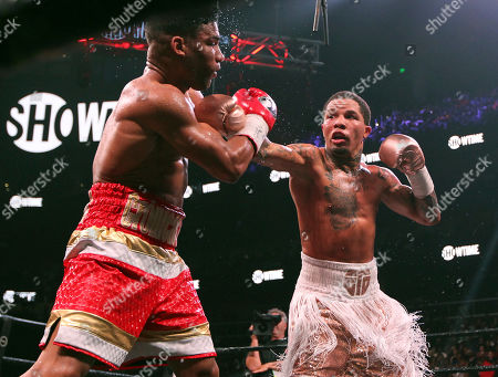 Gervonta Davis, right, lands a punch against Yuriorkis Gamboa during round seven for the WBA lightweight boxing bout, in Atlanta. Davis won the title by a 12th round TKO