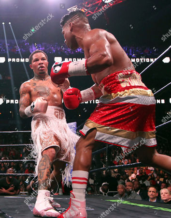 Gervonta Davis, right, tries to avoid a punch by Yuriorkis Gamboa during round eight for the WBA lightweight boxing bout, in Atlanta. Davis won the title by a 12th round TKO