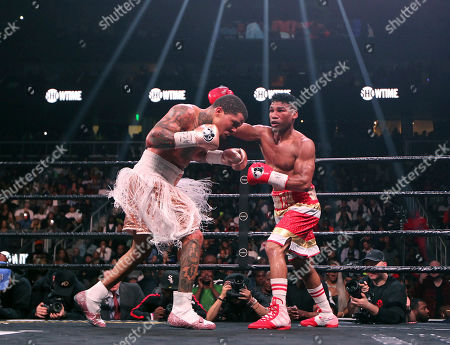 Gervonta Davis, left, fights against Yuriorkis Gamboa during round nine for the WBA lightweight boxing bout, in Atlanta. Davis won the title by a 12th round TKO