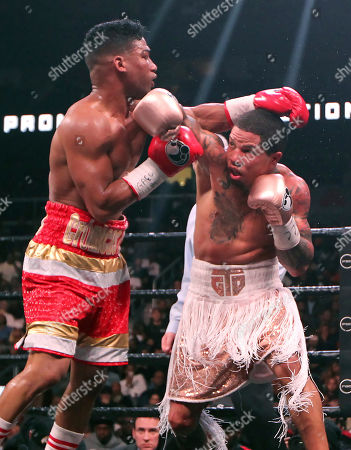 Gervonta Davis, right, fights against Yuriorkis Gamboa during round eight for the WBA lightweight boxing bout, in Atlanta. Davis won the title by a 12th round TKO