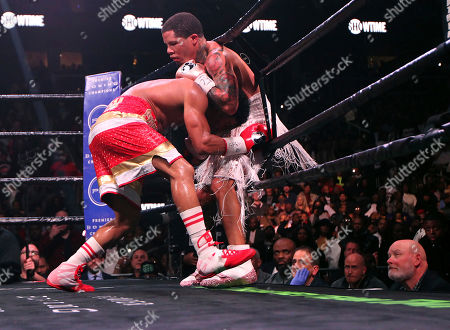 Stock Photo of Yuriorkis Gamboa, left, has Gervonta Davis against the ropes during round nine for the WBA lightweight boxing bout, in Atlanta. Davis won the title by a 12th round TKO
