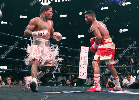 Yuriorkis Gamboa, right, circles opponent Gervonta Davis, in the 12th round as they fight in the WBA lightweight boxing bout n Atlanta