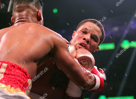 Stock Image of Yuriorkis Gamboa, left, grabs opponent Gervonta Davis, in the sixth round as they fight in the WBA lightweight boxing bout n Atlanta
