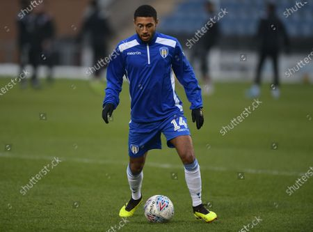 Brandon Comley of Colchester United warming up before kickoff