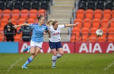 Jill Scott of Manchester City Women chasing the ball with Gemma Davison of Tottenham Hotspur Women
