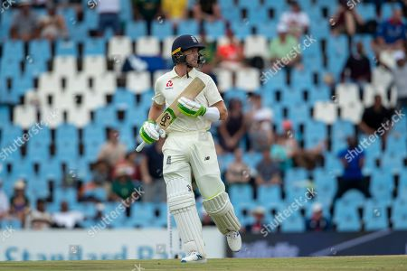 England's batsman Jos Buttler leaves the crease after being caught by South Africa's Dwaine Pretorius for 22 runs on day four of the first cricket test match between South Africa and England at Centurion Park, Pretoria, South Africa, . South Africa beat England by 107 runs