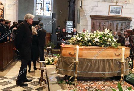 Stephane Le Foll stands near coffin
