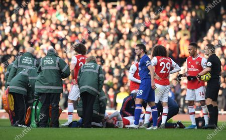 Arsenal's Calum Chambers (C, down) reacts in pain during the English Premier League soccer match between Arsenal FC and Chelsea FC held at the Emirates stadium in London, Britain, 29 December 2019.