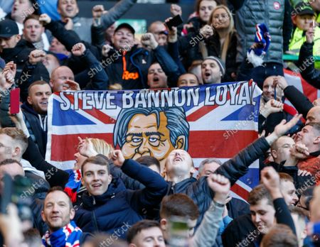 "Rangers fans holding a Union flag reading ""Steve Bannon Loyal"" as they celebrate a 2-1 victory at Celtic Park."