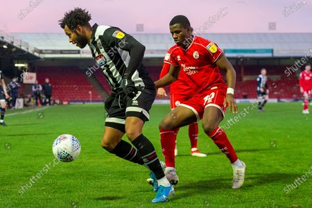Matt Green of Grimsby Town holds off Bez Lubala of Crawley Town during the EFL Sky Bet League 2 match between Grimsby Town FC and Crawley Town at Blundell Park, Grimsby