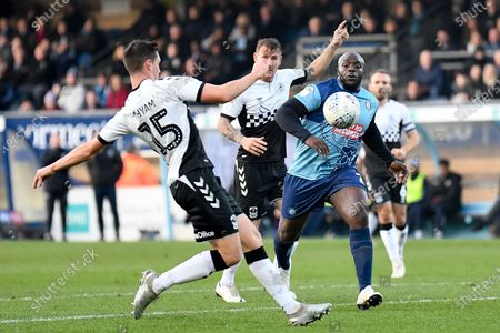 Coventry City defender Dominic Hyam (15) comes into challenge Wycombe Wanderers striker Adebayo Akinfenwa (20) during the EFL Sky Bet League 1 match between Wycombe Wanderers and Coventry City at Adams Park, High Wycombe