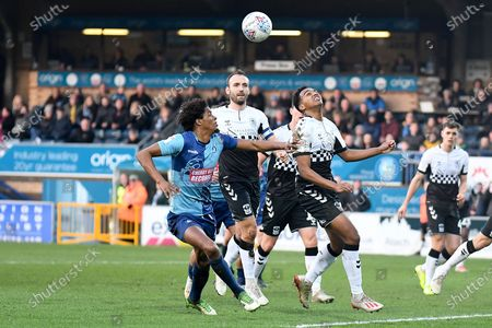 Wycombe Wanderers defender Sido Jambati (2) battles for possession  with Coventry City defender Sam McCallum (31) during the EFL Sky Bet League 1 match between Wycombe Wanderers and Coventry City at Adams Park, High Wycombe