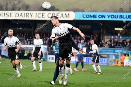 Coventry City defender Dominic Hyam (15) heads the ball during the EFL Sky Bet League 1 match between Wycombe Wanderers and Coventry City at Adams Park, High Wycombe
