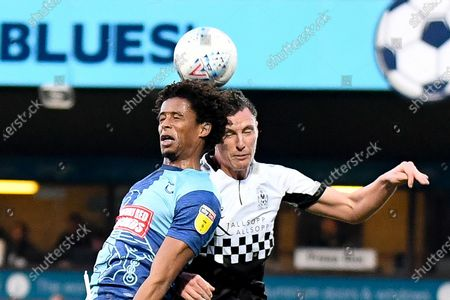 Wycombe Wanderers defender Sido Jambati (2) heads the ball  under pressure from Coventry City defender Dominic Hyam (15) during the EFL Sky Bet League 1 match between Wycombe Wanderers and Coventry City at Adams Park, High Wycombe