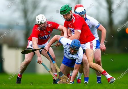 Waterford vs Cork. Waterford's Patrick Curran is tackled by Cork's Chris O'Leary and Aidan Walsh