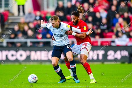 Ashley Williams of Bristol City closes down James Collins of Luton Town