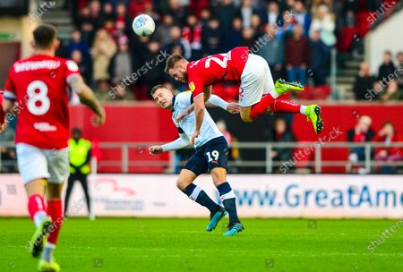 Tomas Kalas of Bristol City challenges for the header with James Collins of Luton Town