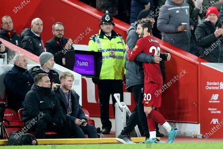 Liverpool midfielder Adam Lallana (20) gets a hug from Liverpool Manager Jurgen Klopp after a good performance during the Premier League match between Liverpool and Wolverhampton Wanderers at Anfield, Liverpool