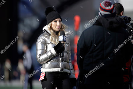 CBS sideline broadcast reporter Melanie Collins works on the sideline in the first half of an NFL football game between the New England Patriots and the Miami Dolphins, in Foxborough, Mass