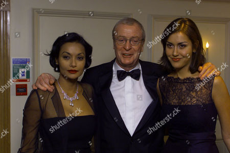 Actor Michael Caine With His Daughter Natasha And Wife Shakira Baksh At The Evening Standard British Film Awards.