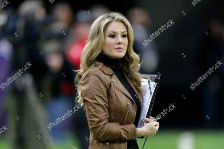 FOX Sports television sideline reporter Jennifer Hale stands on the field before an NFL football game between the Minnesota Vikings and the Chicago Bears, in Minneapolis