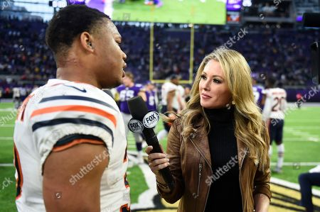 FOX Sports television sideline reporter Jennifer Hale interviews Chicago Bears running back David Montgomery, left, after an NFL football game against the Minnesota Vikings, in Minneapolis. The Bears won 21-19