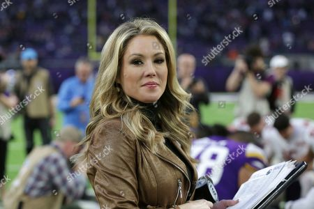 FOX Sports television sideline reporter Jennifer Hale stands on the sideline during the second half of an NFL football game between the Minnesota Vikings and the Chicago Bears, in Minneapolis