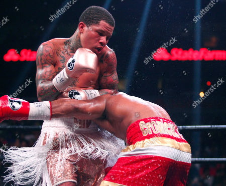 Stock Picture of Yuriorkis Gamboa, right, grabs opponent Gervonta Davis, in the sixth round as they fight in the WBA lightweight boxing bout n Atlanta