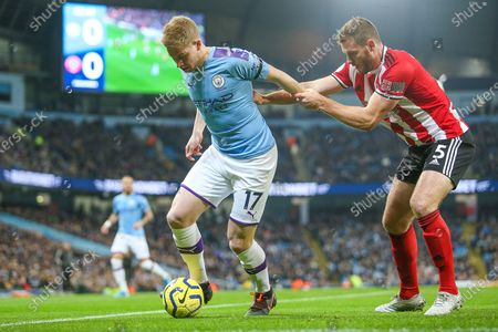 Stock Image of Kevin De Bruyne of Manchester City & Jack O'Connell of Sheffield United during the Premier League match between Manchester City and Sheffield United at the Etihad Stadium, Manchester