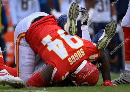 Los Angeles Chargers quarterback Philip Rivers (17) is sacked by Kansas City Chiefs outside linebacker Terrell Suggs (94) during the second half of an NFL football game in Kansas City, Mo