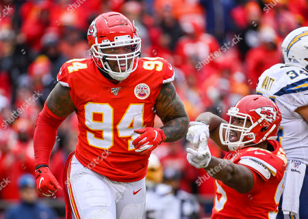 Kansas City Chiefs outside linebacker Terrell Suggs (94) celebrates a sack of Los Angeles Chargers quarterback Philip Rivers (17) during the second half of an NFL football game in Kansas City, Mo