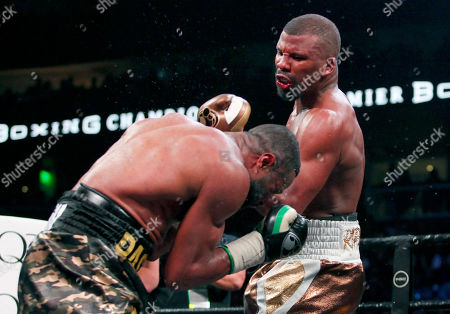 Badou Jack, right, lands a punch on Jean Pascal in the WBA and WBC secondary titles at a light heavyweight match in the tenth round in Atlanta